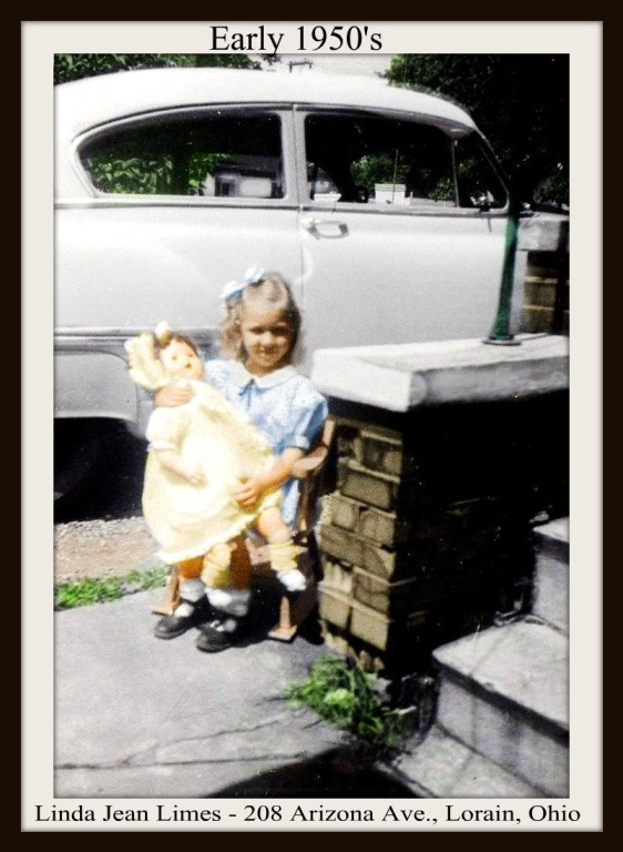 LINDA LIMES AND DOLL ON ROCKER WITH WHITE OLDSMOBILE BEHIND - LORAIN - COLORIZED 5-23-2017 - WITH FRAME & TEXT