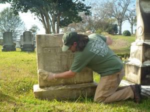 Jason Church cleaning a gravestone